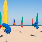 The famous colorful parasols on Deauville beach, Normandy, Northern France